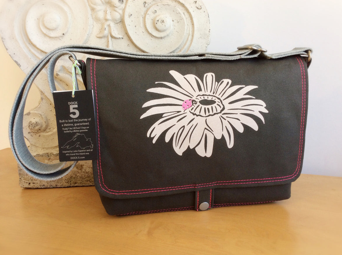 Handcrafted canvas messenger bag with original art print of a Ladybug and Daisy