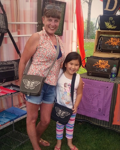 One of my favorite Dock 5 customers! Look how happy she is with her new butterfly messenger bag!