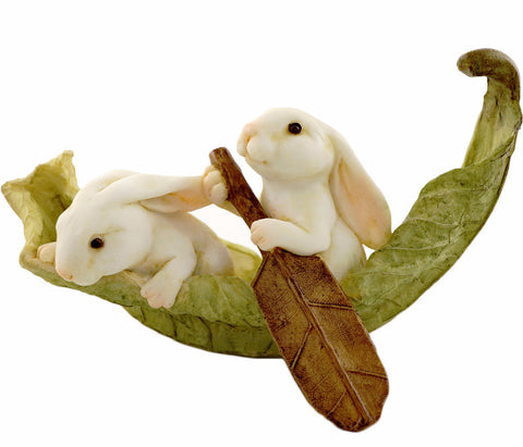 Rabbits Rowing Leaf Boat