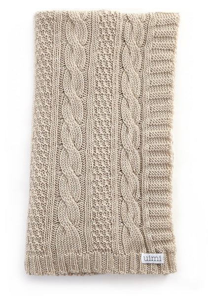 Uimi Trinity Chunky Cable Stitch Merino Blanket. Size: Bassinet. Colour: Oatmeal