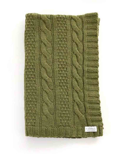 Uimi Trinity Chunky Cable Stitch Merino Blanket. Size: Cot. Colour: Fern