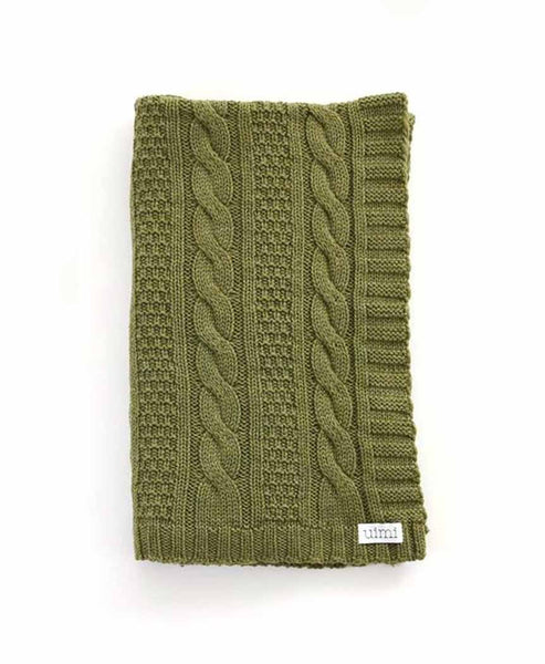 Uimi Trinity Chunky Cable Stitch Merino Blanket. Size: Bassinet. Colour: Fern