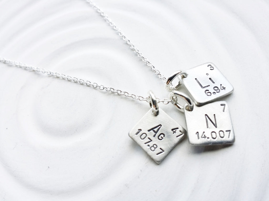 Itty bitty periodic table element necklace elements necklace itty bitty jewelry periodic table element necklace hand stamped personalized jewelry spell urtaz Gallery