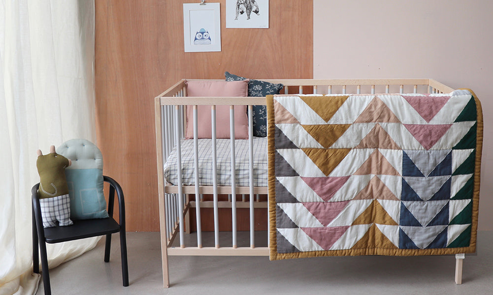 golden and pink triangle quilt by Camomile london