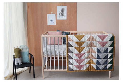Triangle quilt golden nursery room by Camomile london