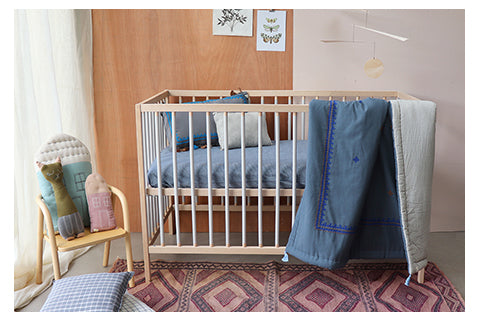 hand embroidered blue quilt unisex nursery by camomile london