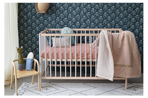 hand embroidered pink quilt and mini check nursery room by Camomile london