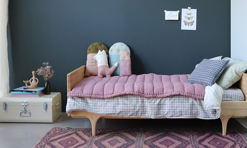 Blush hand quilted blanket and Ikat kids bedding by Camomile London