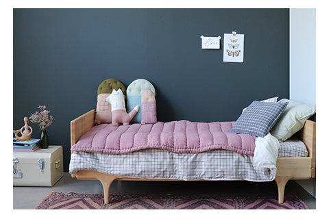 Blush pink hand quilted blanket and contemporary grey and ivory check bedding by camomile london