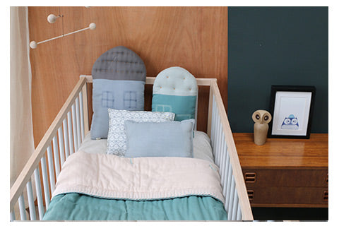 light teal and dash star nursery room