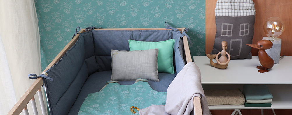 Cot bumper and unisex nursery bedding by Camomile london