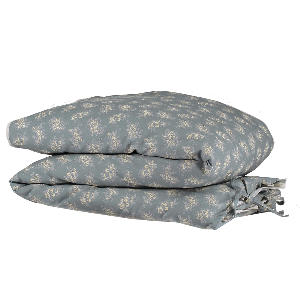 Celia soft blue folded duvet cover with stone floral print folded organic cotton bedding camomile london