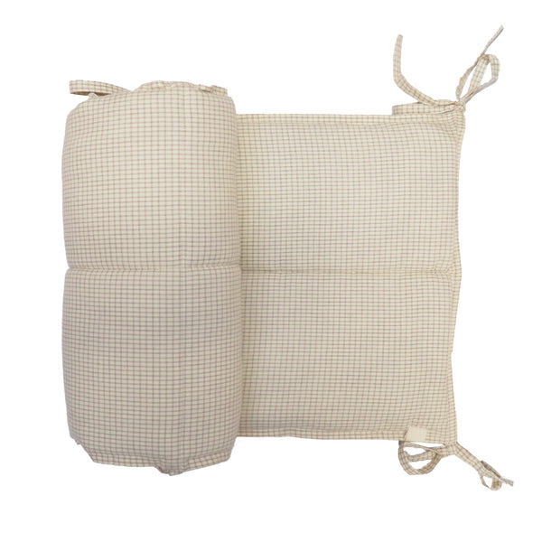 Baby cot bumper 100% cotton woven double check with an ivory base and clay check featuring polyester anti-allergy filling and hand ties to fasten securely bedding by camomile london