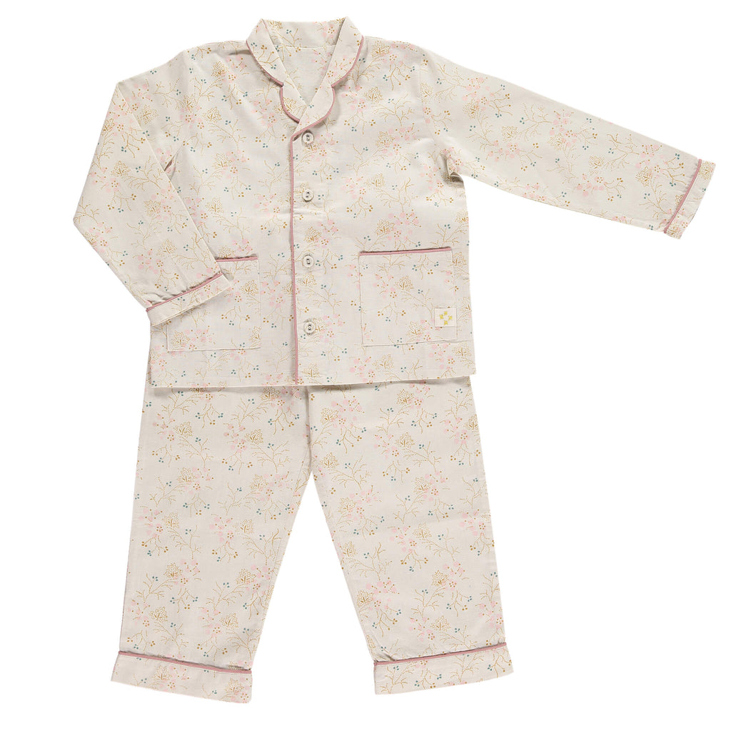Girls 100% soft cotton pyjamas with beautiful piping detail and front pockets, comes in a muslin bag for storage or gifting printed in Minako golden by camomile london
