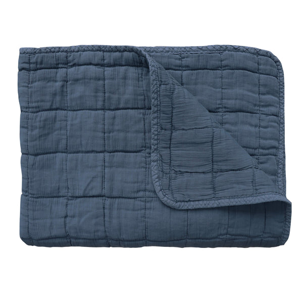 Square quilted blanket in royal navy 100% soft cotton gauze and lightly wadded comes in 4 different sizes bedding by camomile london