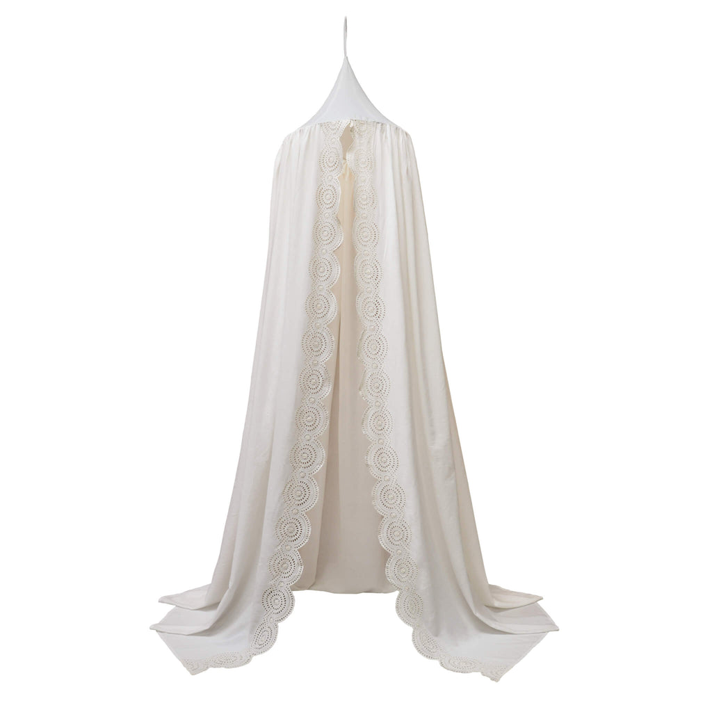 Soft cotton gauze canopy in chalk white with intricate broderie anglais edging, hand cut by skilled artisans. Made by camomile london.