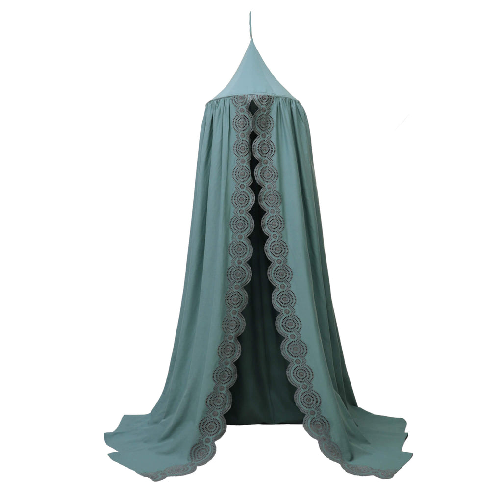 Soft cotton gauze canopy in teal with intricate broderie anglais edging, hand cut by skilled artisans. Made by camomile london.