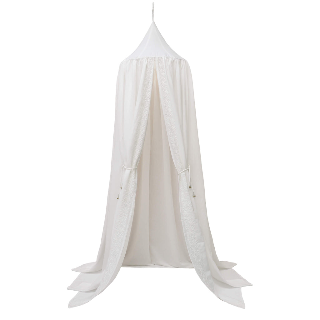 Chalk white 100% cotton canopy with stunning white on white ivy pattern embroidery and white hand ties with gold bell tassels Bedding by camomile london