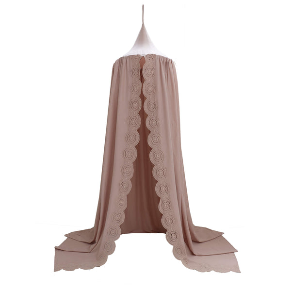 Soft cotton gauze canopy in mink with intricate broderie anglais edging, hand cut by skilled artisans. Made by camomile london.