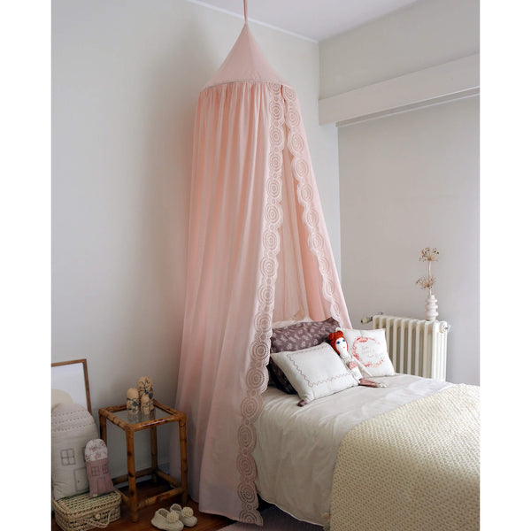 Soft cotton gauze canopy in pale pink with intricate broderie anglais edging, hand cut by skilled artisans. Made by camomile london.