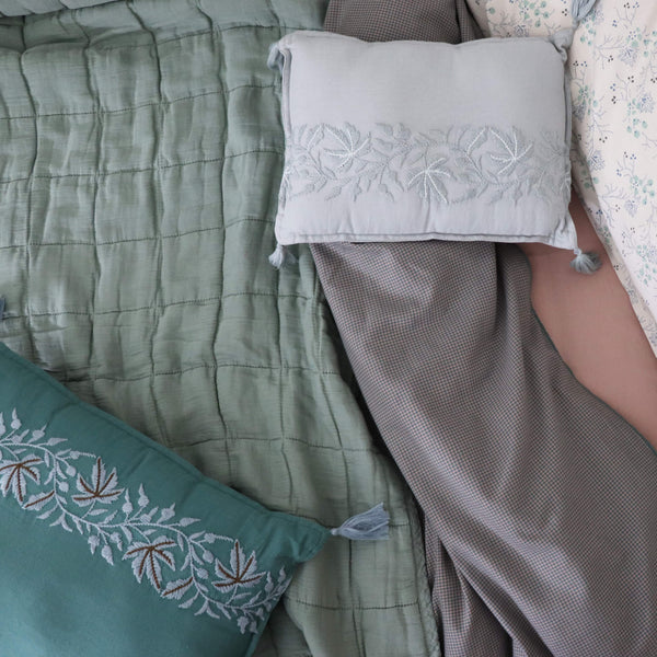 Square quilted blanket in sage 100% soft cotton gauze and lightly filled with anti-allergy polyester comes in 4 different sizes and can be mixed with our beautiful Mini Gingham Check bedding in teal and mink by camomile london