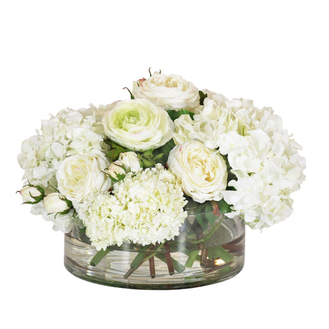 Hydrangea and snowball arrangement in clear vase