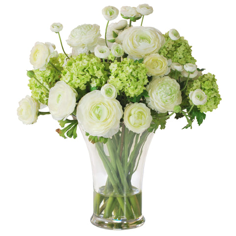 Ranunculus arrangement in glass vase