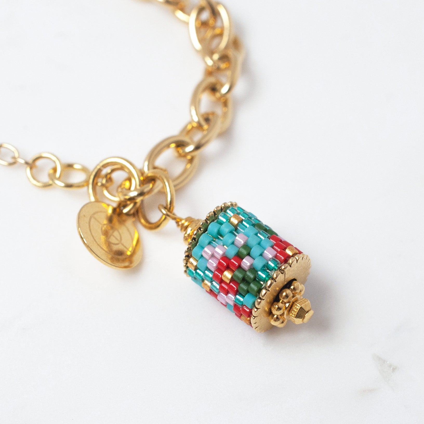 Modern Peranakan charm bracelet blue ethical jewelry