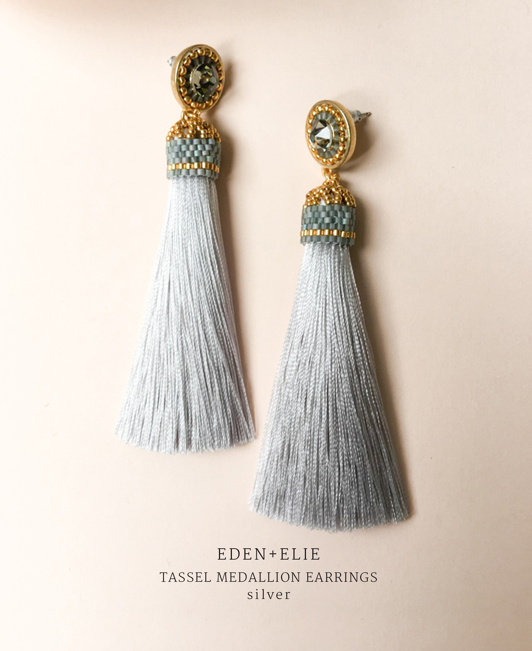 EDEN + ELIE silk tassel statement earrings - silver