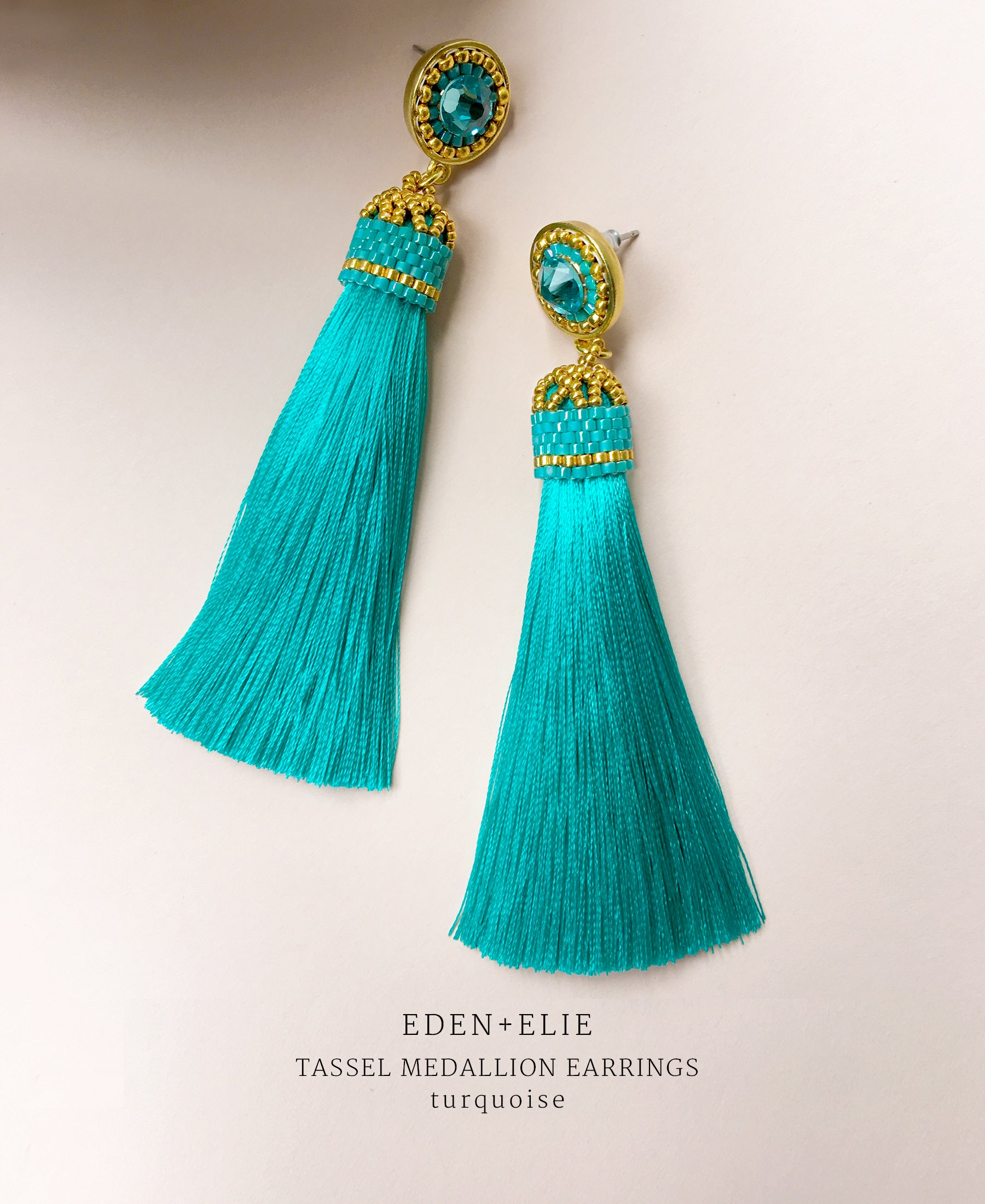 EDEN + ELIE silk tassel statement earrings - turquoise