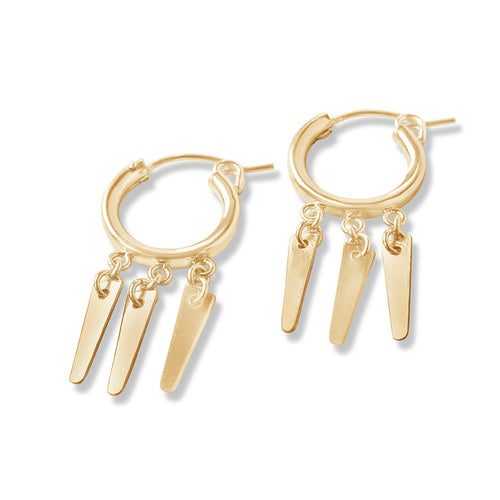 Gold spike huggie earrings, spikes hang from a gold hoop
