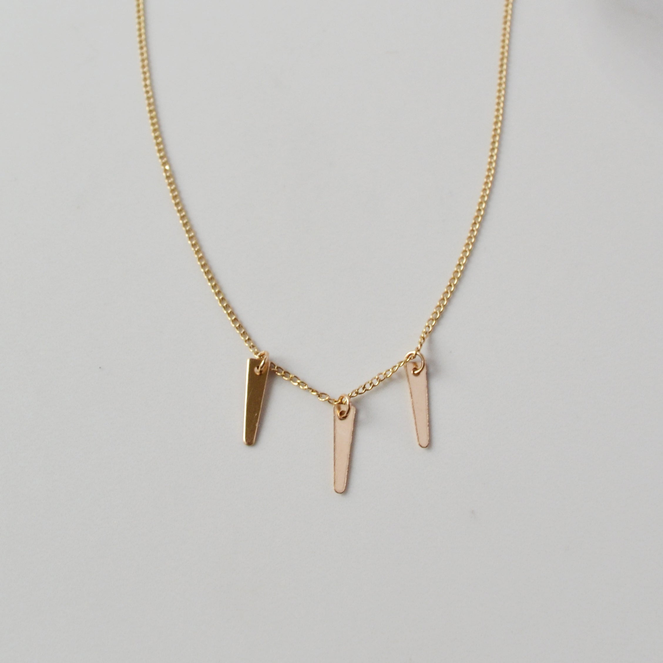 detail of spike necklace in gold
