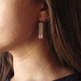 silver bar earrings on model