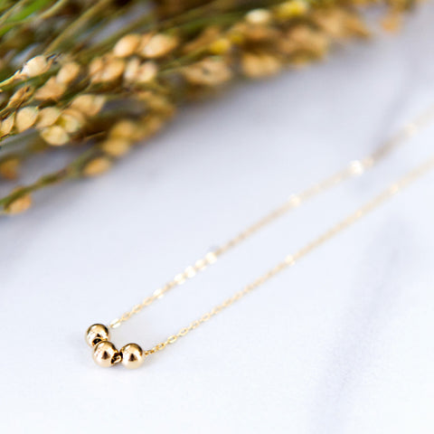 Three tiny beads necklace in sterling silver or 14k gold filled by Blossom and Shine