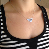 black asymmetrical triangle necklace on model