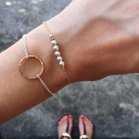Dainty hammered circle bracelets in mixed metals or sterling silver or 14k gold filled by Blossom and Shine