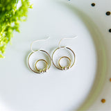 Mixed metal circle dot earrings in sterling silver and 14k gold filled by Blossom and Shine
