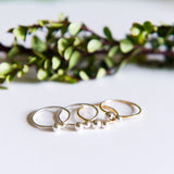 Mixed metal dainty dot stacking rings in sterling silver or 14k gold filled by Blossom and Shine