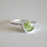 green coiled paper bead ring