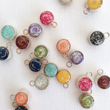 Add a handmade paper bead charm in sterling silver or 14k gold filled to any necklace by Blossom and Shine
