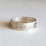 Dainty thin hammered stacking rings in sterling silver or 14k gold filled by Blossom and Shine