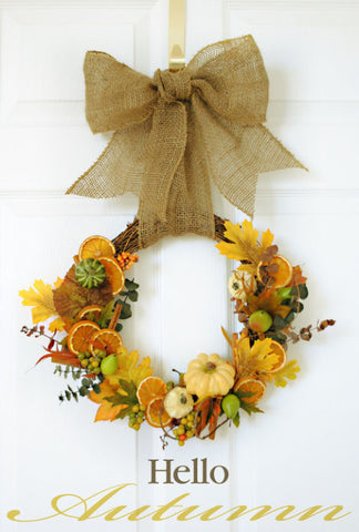 Seasonal autumn wreath with burlap bow