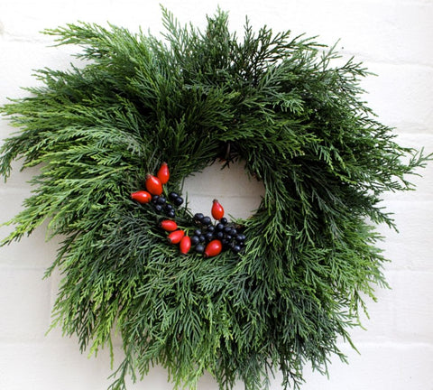 Evergreen wreath with bright red berrues