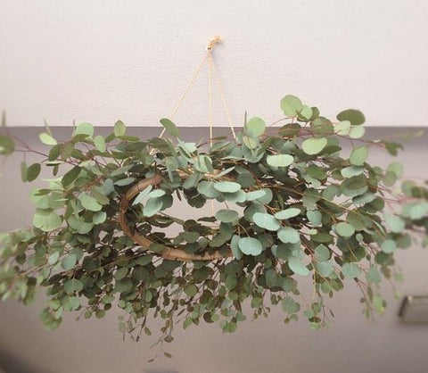 hanging eucalyptus wreath with overflowing branches