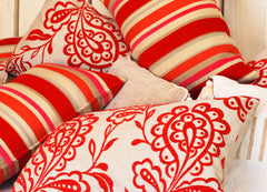 Pillows in bright red and orange colors