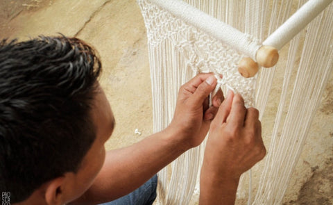 Artisan working on a macrame baby swing chair