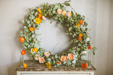 Wreath made of seasonal greens and flowers