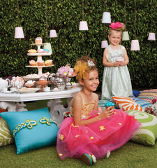 young girls eating cupcakes on outdoor pillows from Elaine Smith