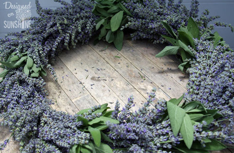 wreath of dried lavendar laying on rustic wood table