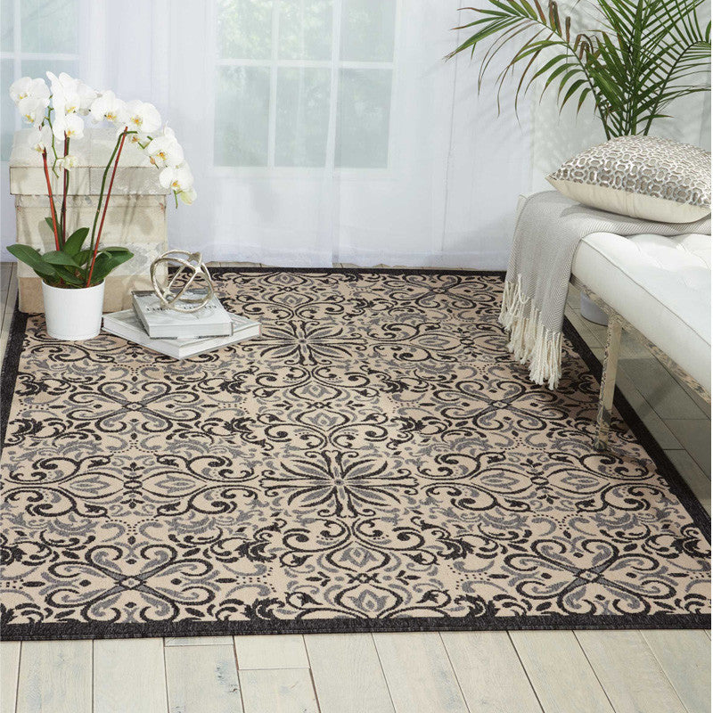 Magdalenea Outdoor Indoor/Outdoor Rug Ivory and Charcoal in a room